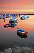 Moored Photos - Moored Boats On Sea At Sunset by Juampiter