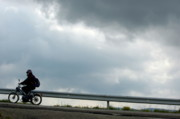 Sami Sarkis - Moped on a road against a stormy sky