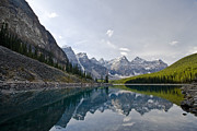 Reflection Of Trees In Lake Prints - Moraine Lake In Banff National Park Print by Zoltan Kenwell