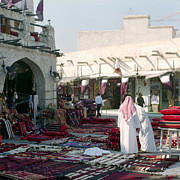 Arabs Photos - Morning in Souq Waqif  Qatar by Paul Cowan