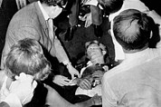 Bobby Kennedy Prints - Mortally Wounded Robert Kennedy. After Print by Everett