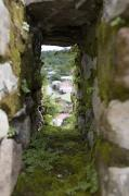 Battlement Posters - Moss Covered Battlement Hole In Ancient Poster by David Evans
