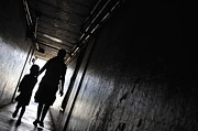 Bonding Metal Prints - Mother and daughter walking in a dark corridor Metal Print by Sami Sarkis