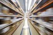 Conveyor Belt Posters - Motion Blur Of A Warehouse Conveyor Belt Poster by John Short