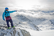Alps Prints - MOUNTAIN GUIDE snowboard instructor pointing out peaks in Davos Print by Andy Smy