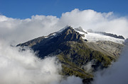 Mountain Top Framed Prints - Mountain top in the clouds Framed Print by Matthias Hauser