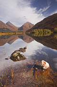Glen Etive Prints - Mountains Reflecting Into Lochan Urr In Glen Etive Print by Julian Elliott Ethereal Light