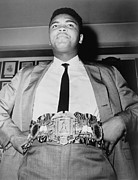 Gold Belt Prints - Muhammad Ali B. 1942, Displays The Print by Everett