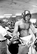 Boxing  Prints - Muhammad Ali sneers after rubbing Print by Jan Faul
