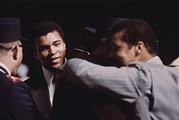 Boxing  Framed Prints - Muhammad Ali Talks With Fellow Black Framed Print by Everett
