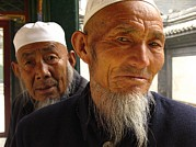 Peoples Republic Of China Photos - Muslim Worshippers In Traditional by Richard Nowitz