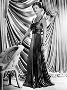 Full-length Portrait Posters - Myrna Loy Wearing Green And Yellow Gold Poster by Everett