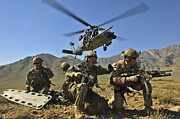 Assault Rifles Photo Framed Prints - N Hh-60g Pave Hawk Hovers Framed Print by Stocktrek Images