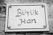 Cumhuriyeti Posters - nameplate on the exterior of buyuk han the great inn in nicosia TRNC turkish cyprus Poster by Joe Fox