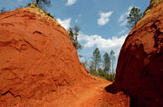 Dirt Road Posters - Narrow passage between two bright red sandy cliffs Rustrel Canyon Poster by Sami Sarkis