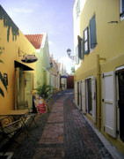 Woman In A Dress Photo Posters - Narrow Street in Curacao Poster by Sharon Kalniz