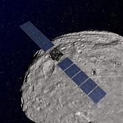 Nasas Dawn Spacecraft Orbiting Print by Stocktrek Images