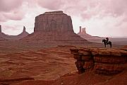 Native American Art - Navajo Elder on Horseback Monument Valley Tribal Park by Brian M Lumley