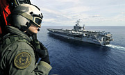 Aircraft Carrier Prints - Naval Air Crewman Conducts A Visual Print by Stocktrek Images