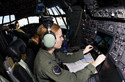 Co-pilot Posters - Navigator At Work In A Mc-130p Combat Poster by Gert Kromhout