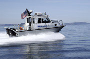 Police Patrol Law Enforcement Prints - Navy Region Northwest Police Conduct Print by Stocktrek Images