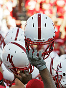 Wall Art Photos - Nebraska Football Helmets  by University of Nebraska