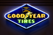 Flag Framed Prints - Neon Goodyear Tires Sign Framed Print by Mike McGlothlen
