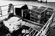 Lobster Pots Prints - new lobster pots piled up in the back of a small fishing boat at John OGroats harbour scotland Print by Joe Fox