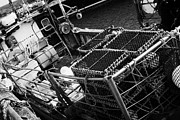 Lobster Pots Prints - new lobster pots piled up on the deck of a small fishing boat at John OGroats harbour scotland uk Print by Joe Fox