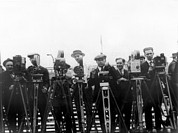 Journalist Framed Prints - Newsreel Cameramen With Cameras Framed Print by Everett