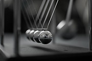 Black And White Photography Photos - Newtons Cradle In Motion - Metallic Balls by N.J. Simrick