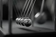 Newton's Cradle In Motion - Metallic Balls Print by N.J. Simrick