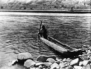 Nez Perc� Canoe. Nez Perc� Man Print by Everett