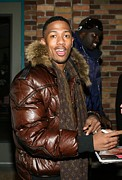 Puffer Photo Framed Prints - Nick Cannon Wearing Louis Vuitton Scarf Framed Print by Everett