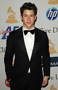 Beverly Hilton Hotel Framed Prints - Nick Jonas In Attendance For Clive Framed Print by Everett