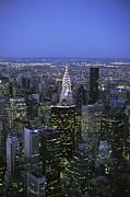 Night View Of The Manhattan Skyline Print by Todd Gipstein
