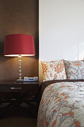 Showcase-interior Photo Framed Prints - Nightstand and Lamp Next to a Bed Framed Print by Inti St. Clair
