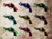 Pop Prints - Nine Revolvers Print by Michael Tompsett