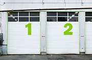 Workplace Photo Framed Prints - Numbers On Repair Shop Bay Doors Framed Print by Don Mason