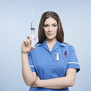 Frightening Posters - Nurse With Syringe Poster by Kevin Curtis