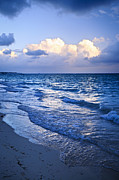 Cloudscape Posters - Ocean waves on beach at dusk Poster by Elena Elisseeva