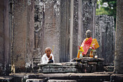 Religious Characters And Scenes Photos - Offerings Made To Buddha At Angkor Wat by Steve Raymer