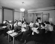 Typewriters Photos - Office With Many Women Performing by Everett