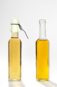 Olive Oil Photo Prints - Oil and vinegar bottles Print by Matthias Hauser