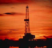Oil Drilling Framed Prints - Oil Drilling Rig, Russia, At Sunset Framed Print by Ria Novosti