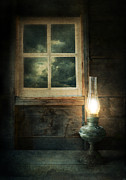 Gloomy Framed Prints - Oil Lamp on Table by Window Framed Print by Jill Battaglia