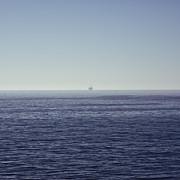 Oil Rig On Ocean Print by Eddy Joaquim