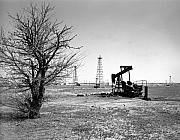 Black And White Photo Framed Prints - Oklahoma Oil Field Framed Print by Larry Keahey
