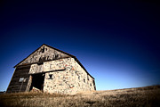 Farm Building Prints - Old barn on the Prairies Print by Mark Duffy