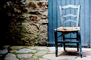 Chair Photo Framed Prints - Old Blue Wooden Caned Seat Chair At Doorstep Framed Print by Alexandre Fundone